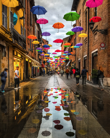 Colorful umbrellas in Italian alley