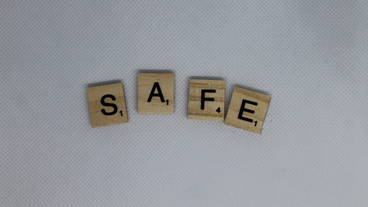 Scrabble tiles spelling out the word 'safe'